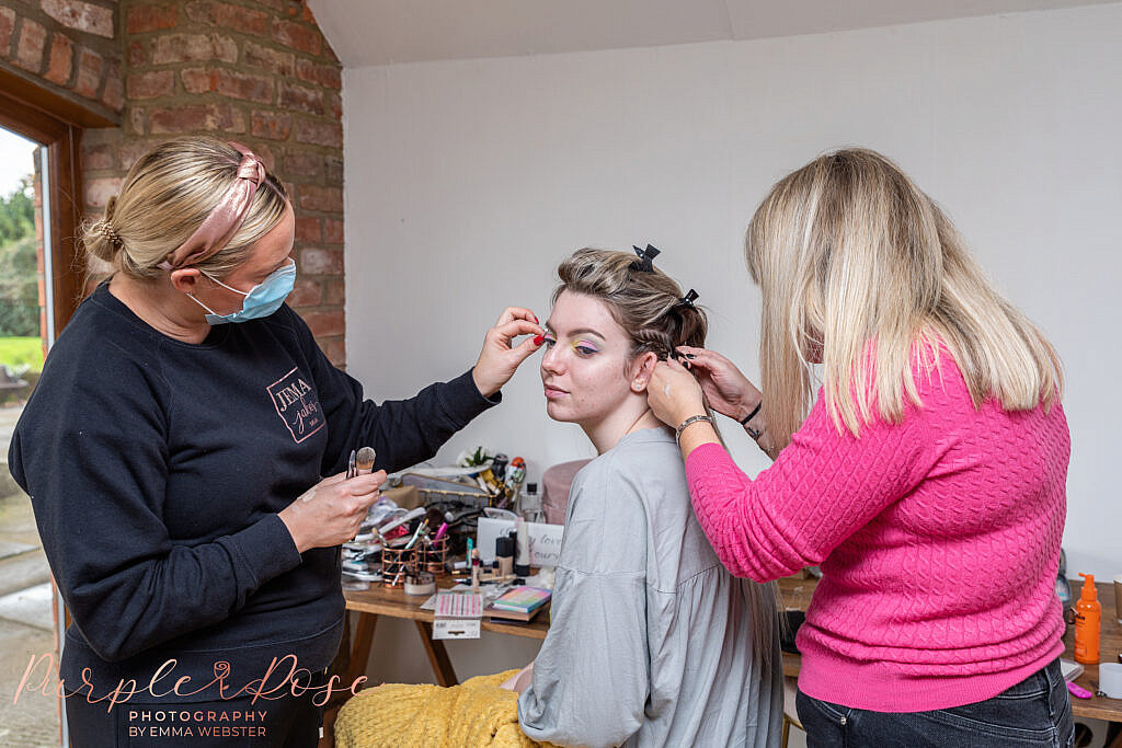 Bride having her hair and makeup applied