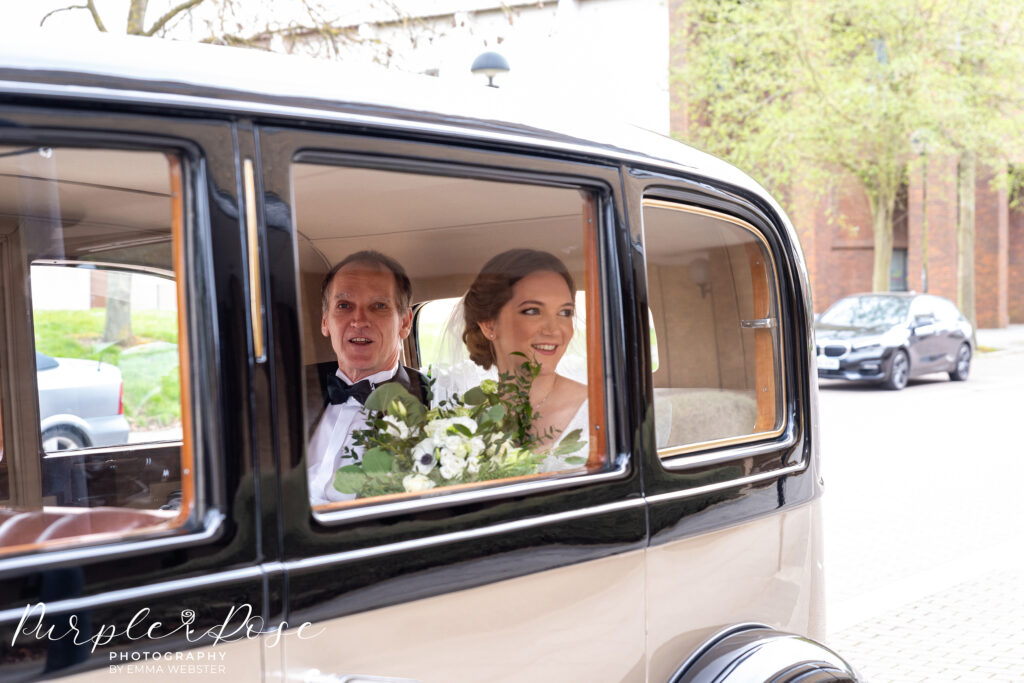 Bride arriving in a car at registry office