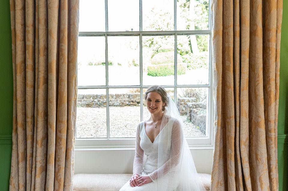 Bride sat by a window