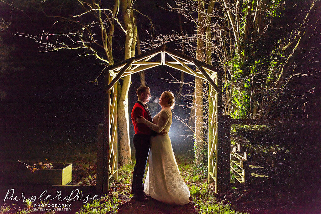 Bride and groom in an archway