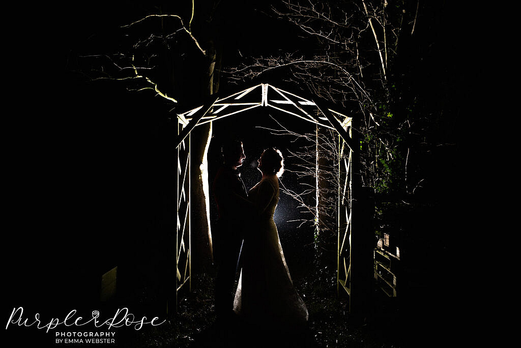 Bride and groom under an archway