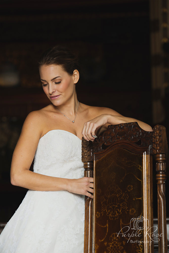 Bride leaning on a chair back
