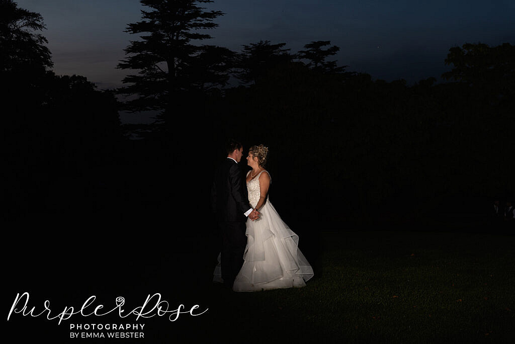 Bride and groom after dark