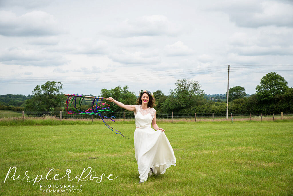Bride running with ribbons