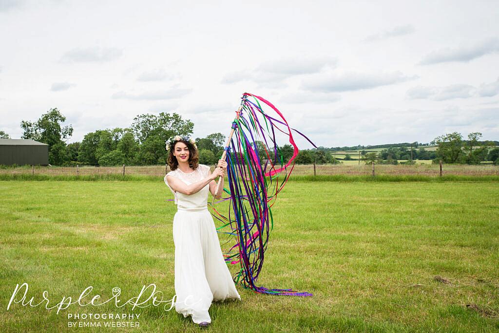 Bride holding ribbons aloft