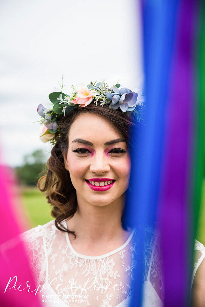 Bride framed by ribbons
