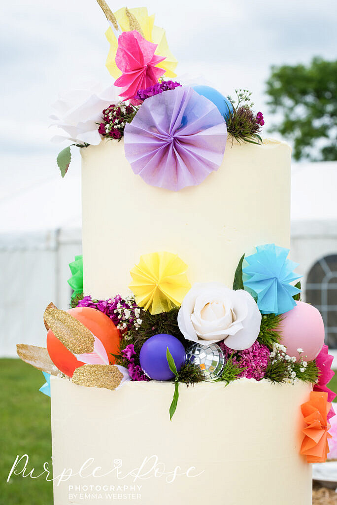 Wedding cake covered in balloons and feathers