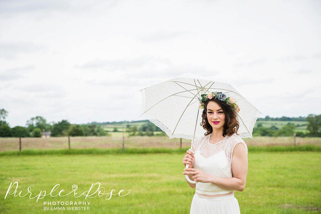 brie holding an umbrella