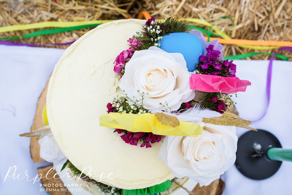 Cake decorated with balloons and flowers