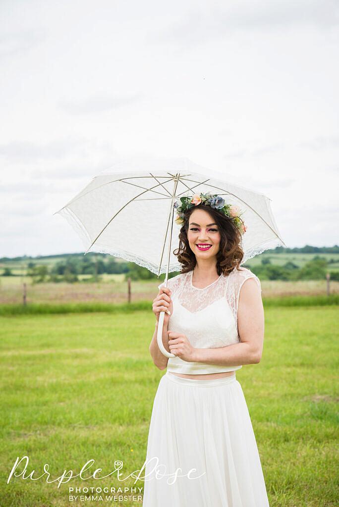Bride holding a lace umbrella