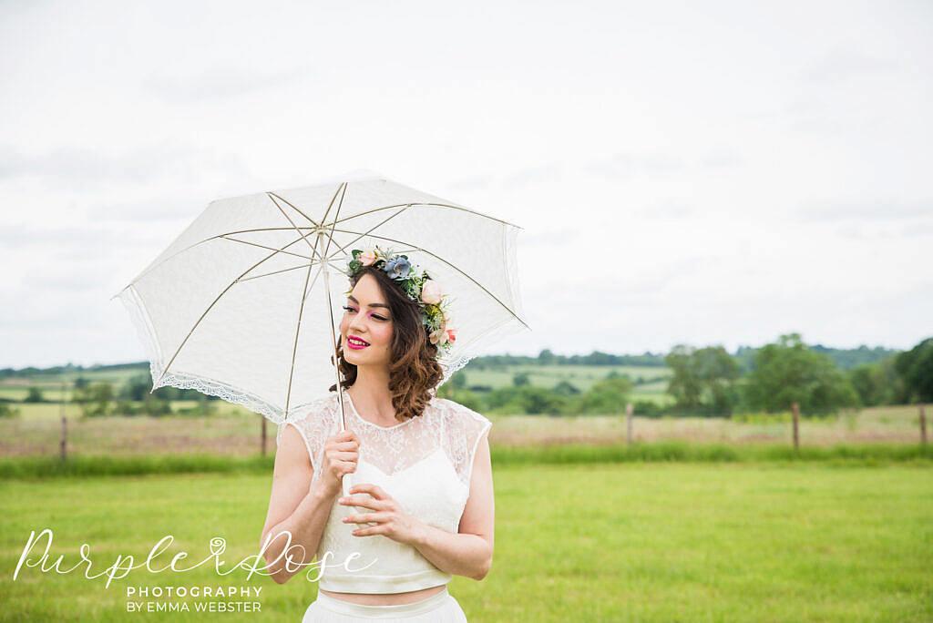 Bride with a lace umbrella