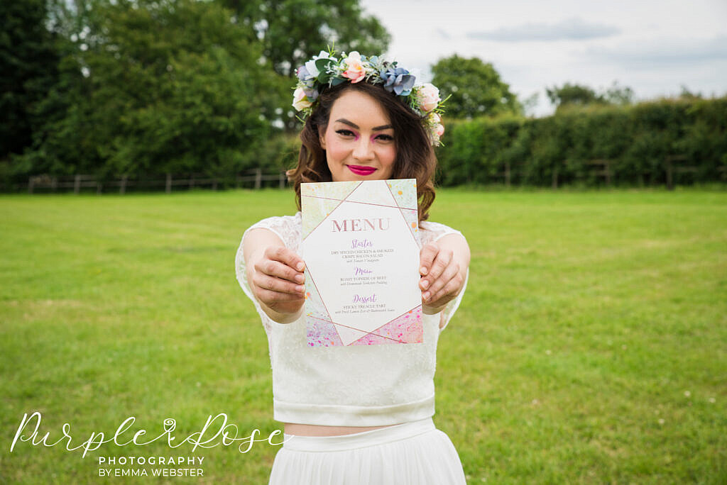 bride smiling while holding a menu