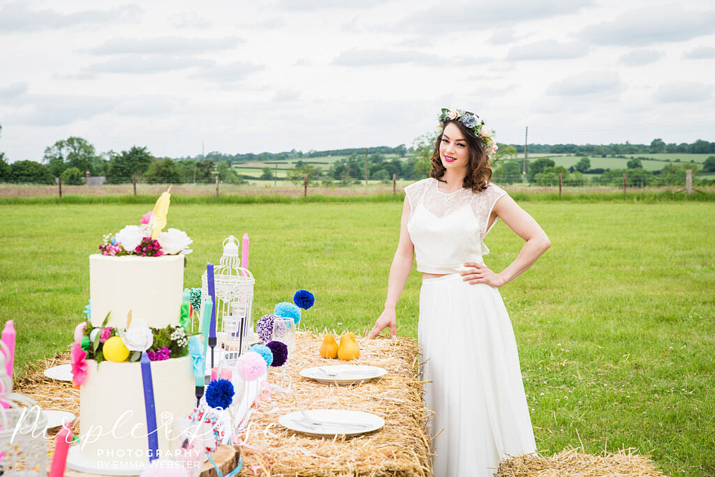 bride looking at wedding table setup
