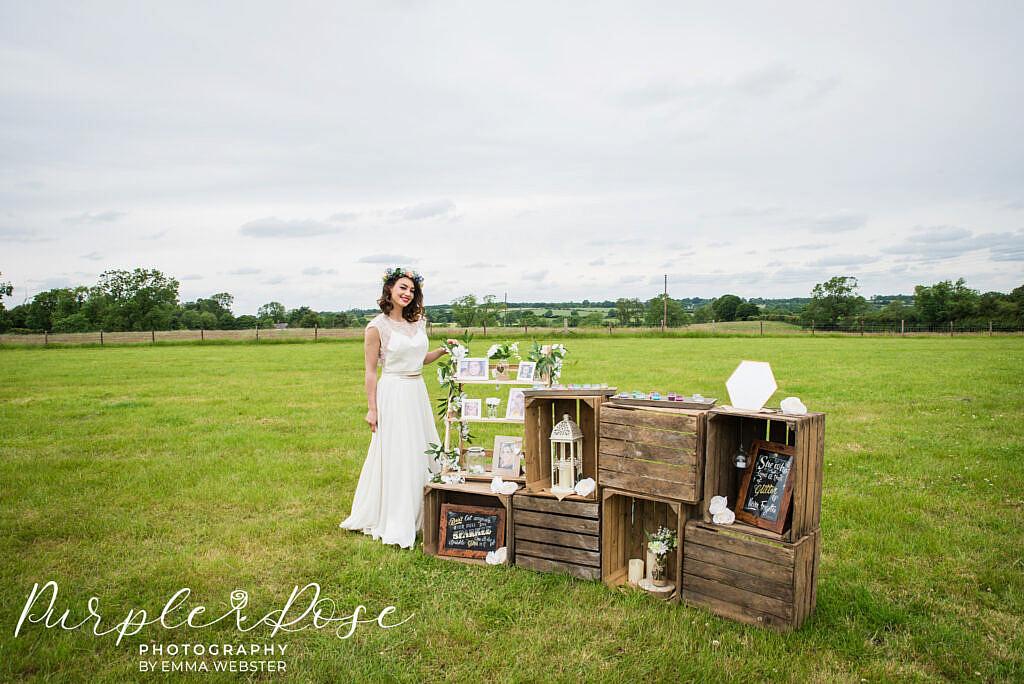 Bride standing by a glietter bar