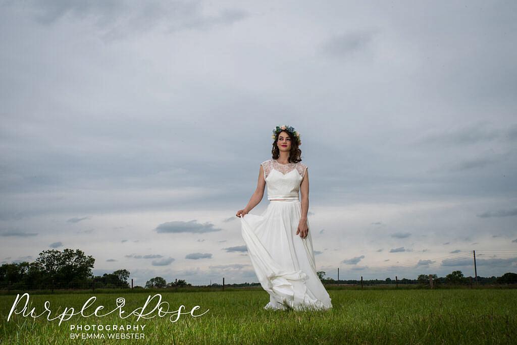 bride swooshing her dress