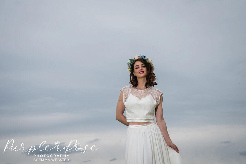 bride framed by a storm sky