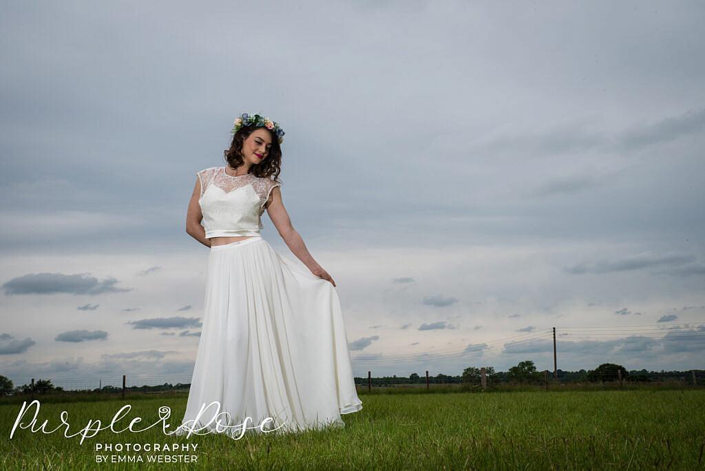 bride swishing her dress