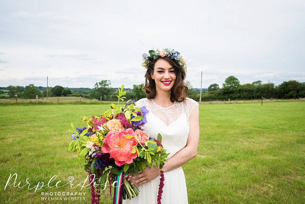 bride smiling while holding her flowers