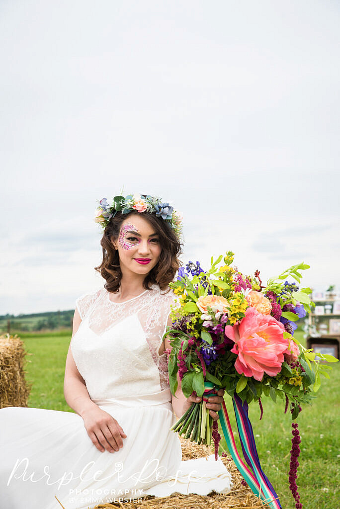 bride sitting and holding her flowers