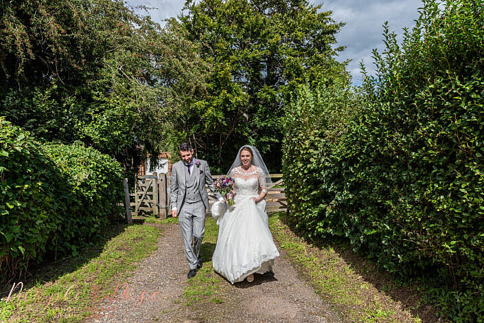 Couple walking together after their wedding ceremony