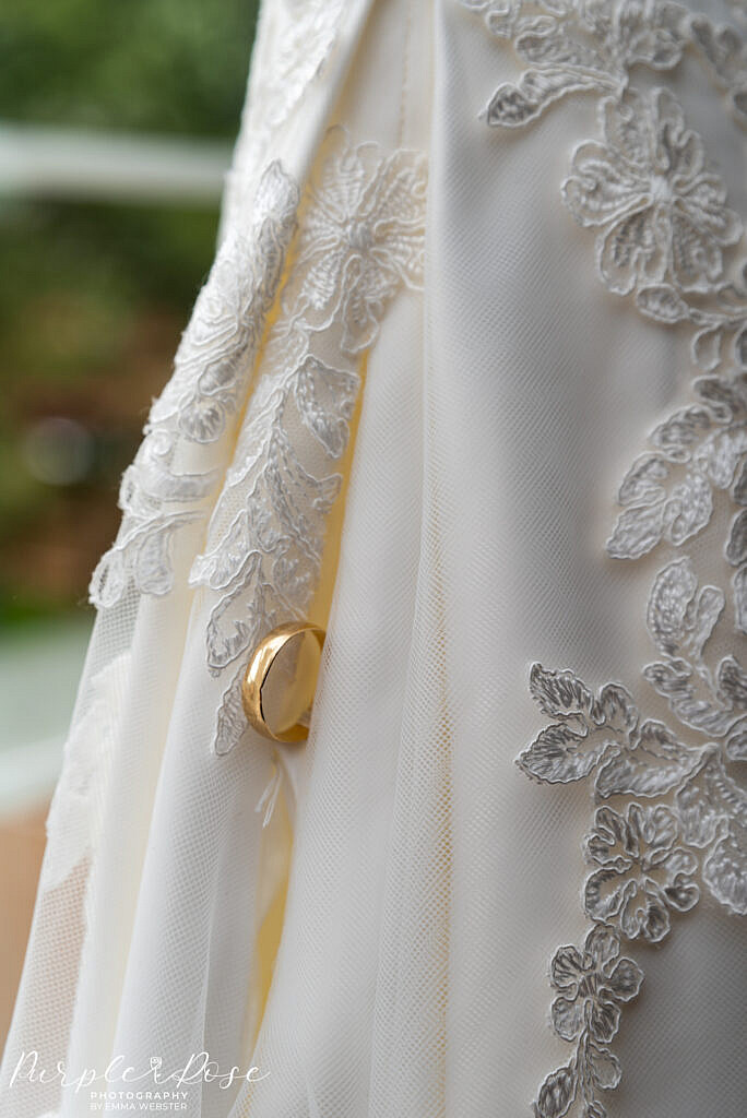 Wedding ring with a brides dress