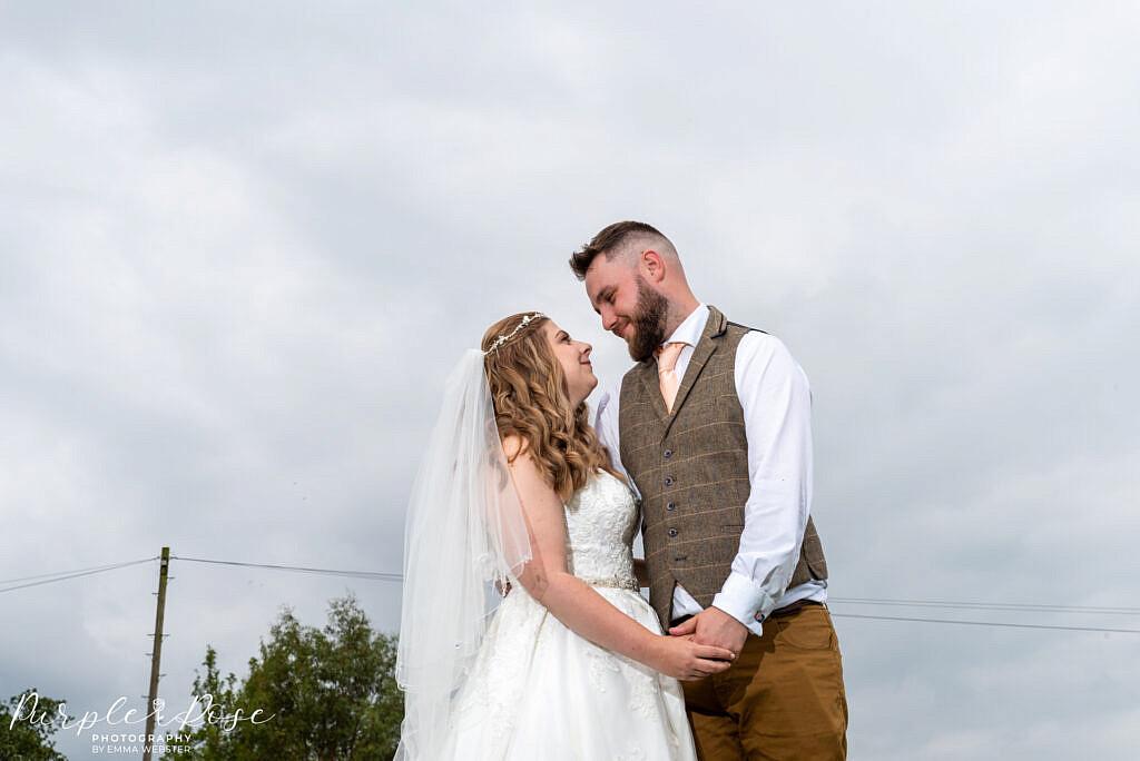 bride and Groom posing in gardens at Newton Park Farm