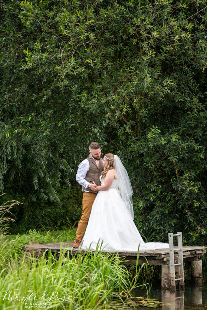 Bride and groom on a fishing platform