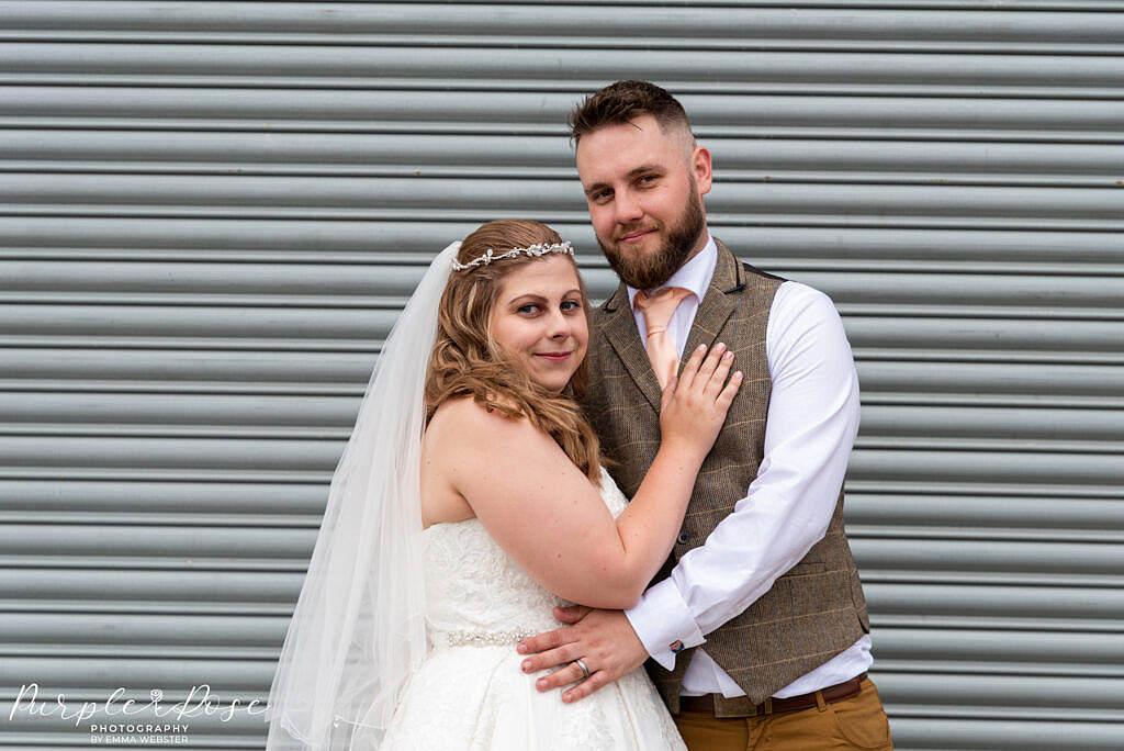 Couple in front of metal barn door
