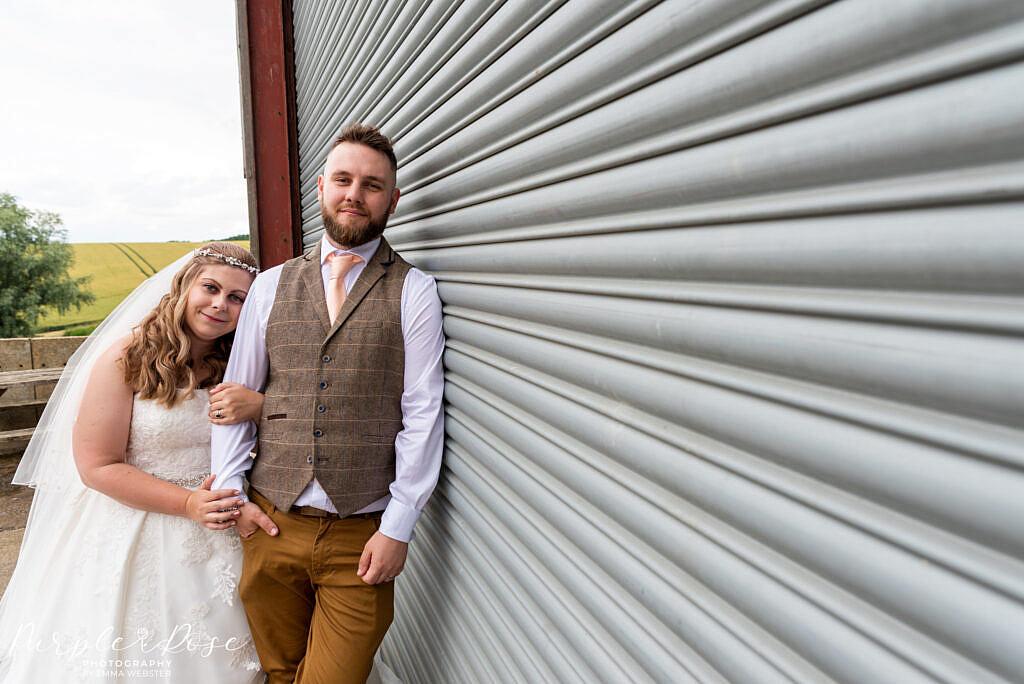 Couple leaning on barn door