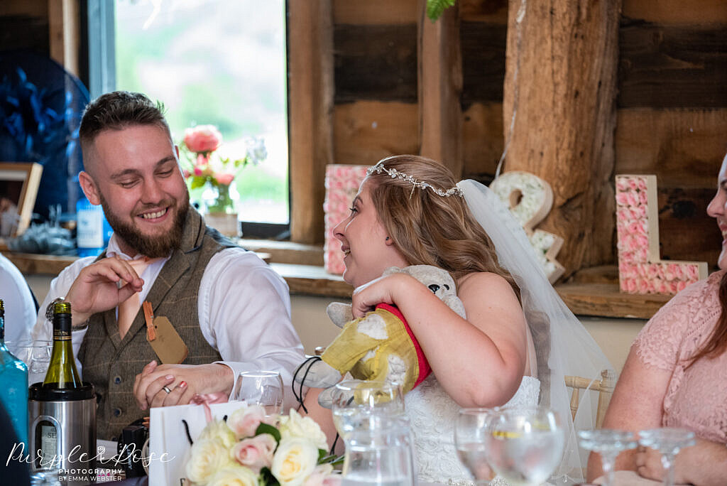 Couple laughing during wedding speaches