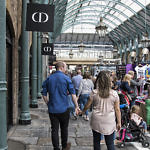 Couple walking handing in hand through Covent Garden