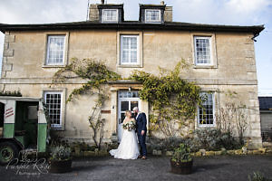 Bride and groom standing outside their wedding venue