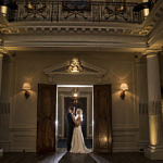 Bride and groom standing in a doorway