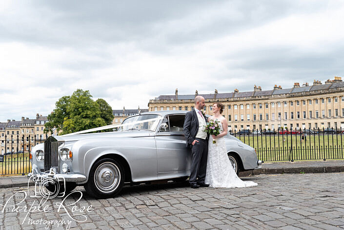 bride and groom at Royal Circle with their wedding car