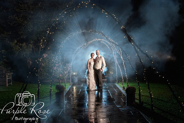 Dramatic night time photo of bride and groom