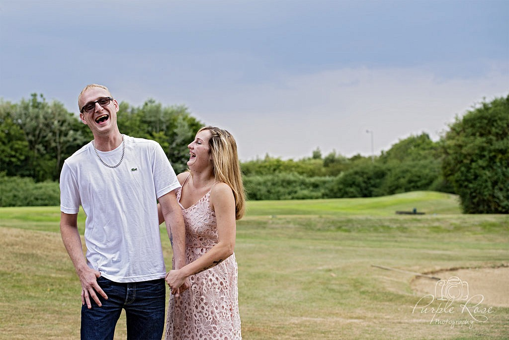 Couple laughing at their pre wedding shoot