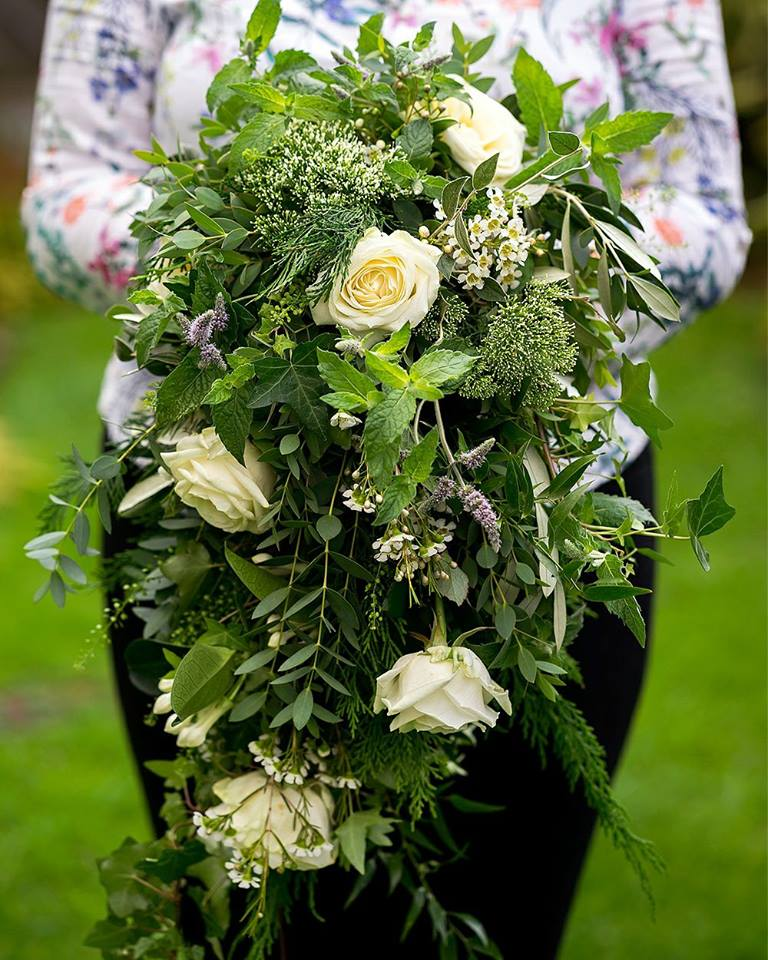 White bridal bouquet with foliage