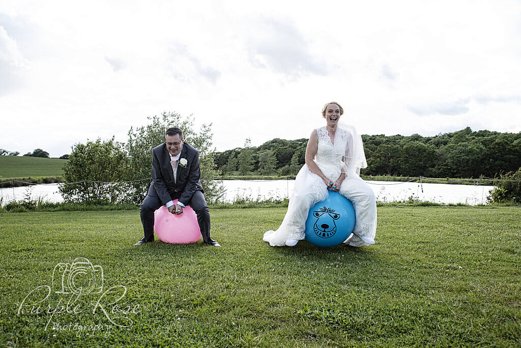 Bride and Groom racing on a space hopper