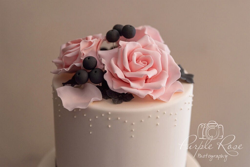 Pink and purple wedding cake topper