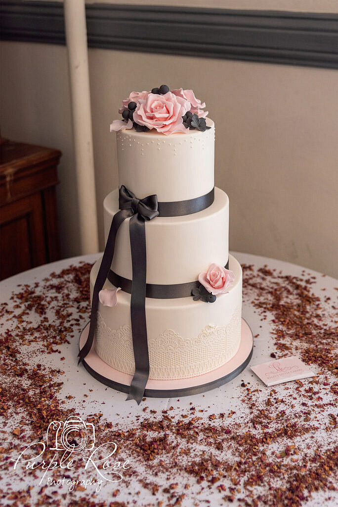 Wedding cake surrounded by confetti