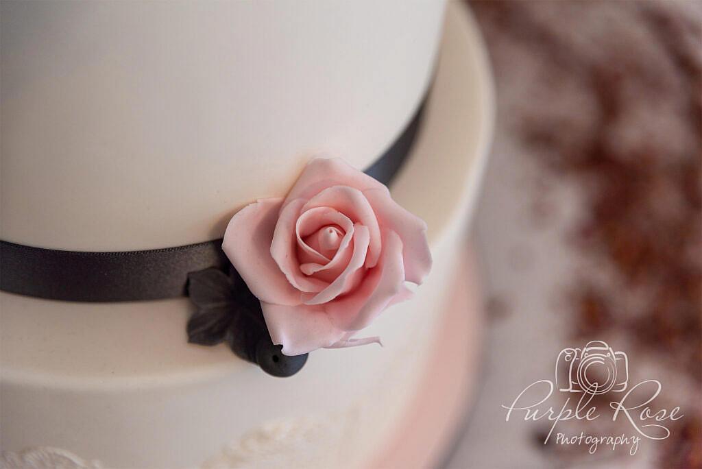 Close up of a sugar rose on a wedding cake