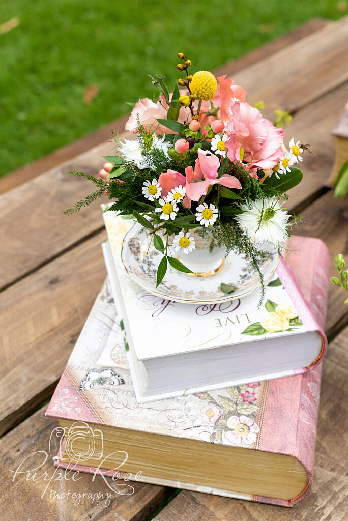 Flowers stacked on books