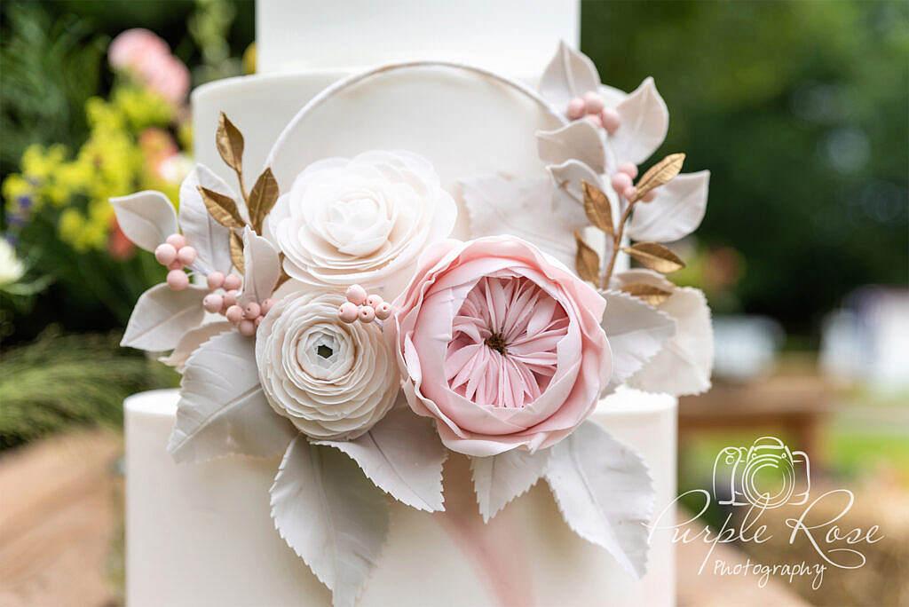 Intricate flowers on a wedding cake