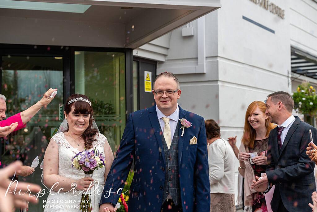 Bride and groom leaving their wedding