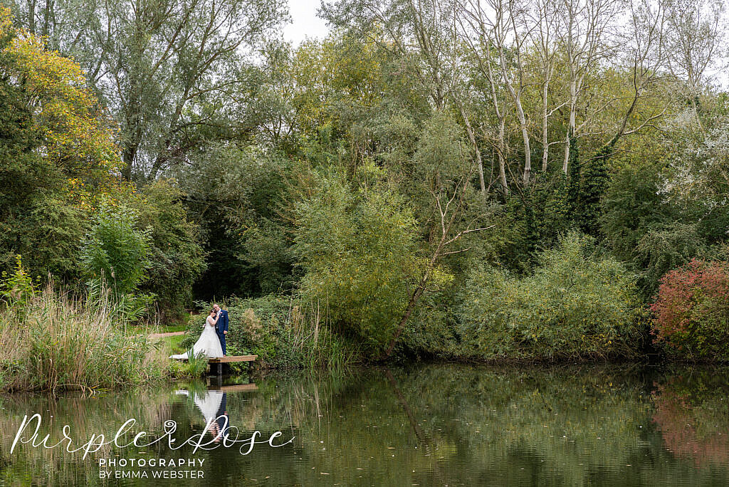 Bride and groom by a lake