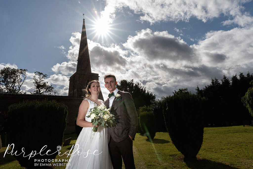 Bride and groom in front of their church