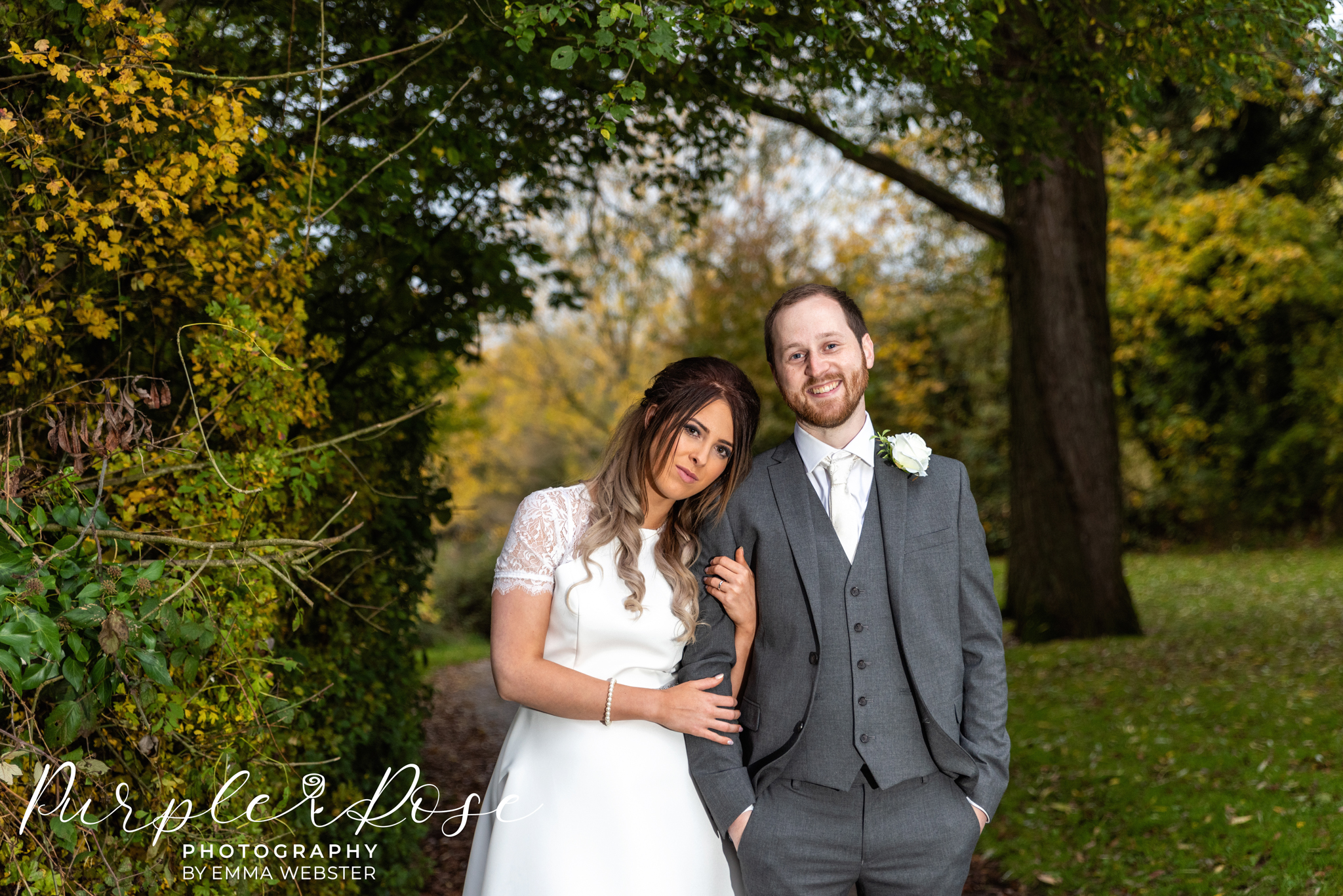 Bride and groom framed by trees