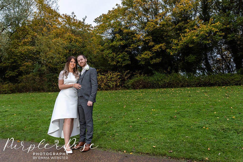 Bride and groom enjoying the autumn setting