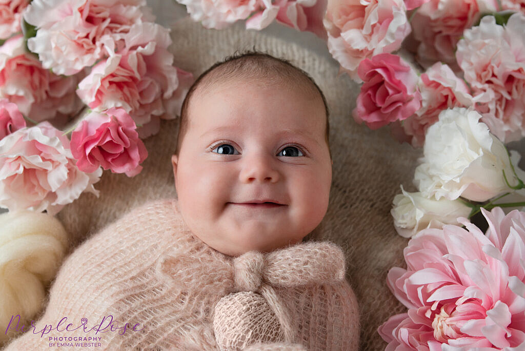Baby smiling at the camera