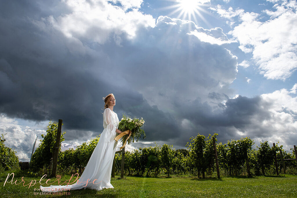 Bride stood in front of a stormy sky